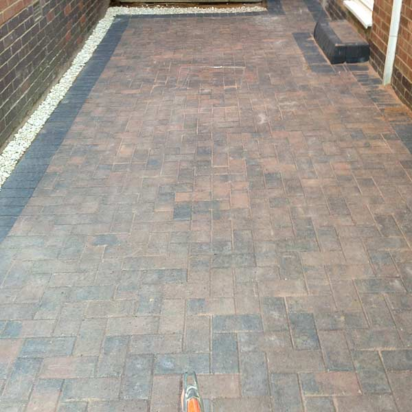 Block paving at side of house