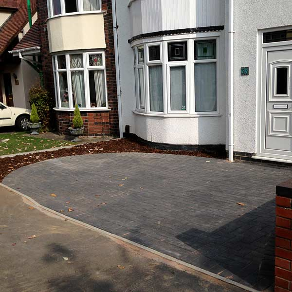 New paved driveway with circle edge