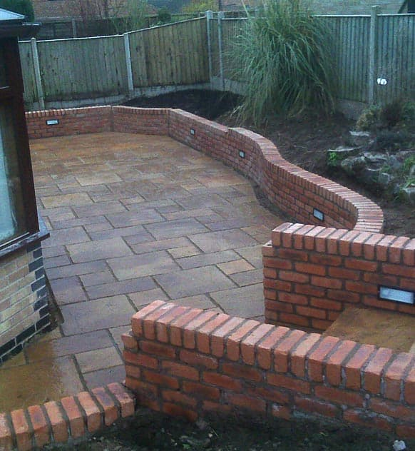 New garden with low walls built around flower beds