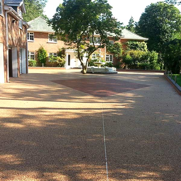 Driveway designs with resin bound gravel