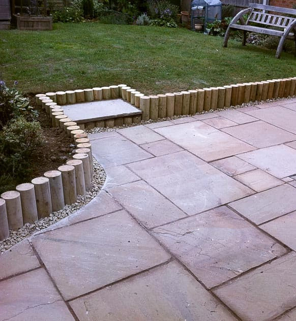 Garden slabbed area with Log Roll Edging