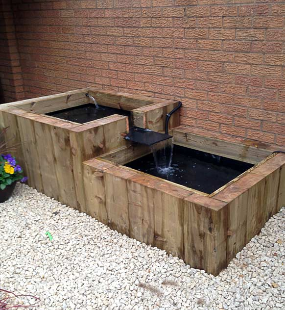 Water feature from wooden sleepers