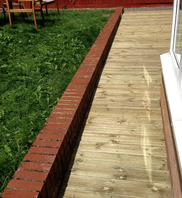 Decking area with small wall surrounding