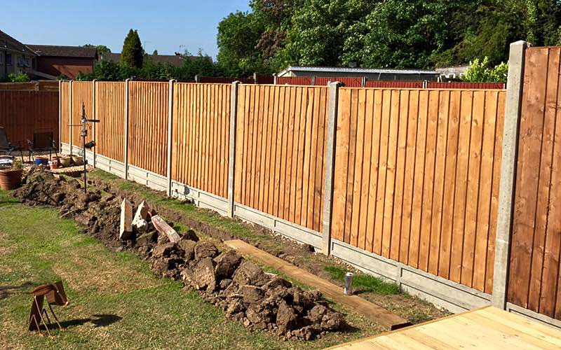 Concrete supports with closeboard fencing