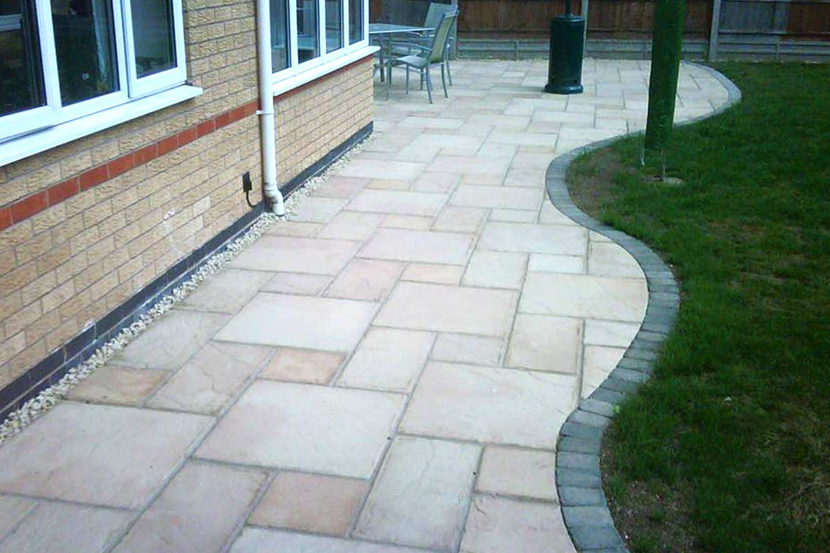 Patio designs installations ultimate landscapes ltd for Garden decking and slabs