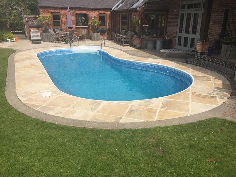 Patio designs installations ultimate landscapes ltd for Outdoor swimming pool leicester
