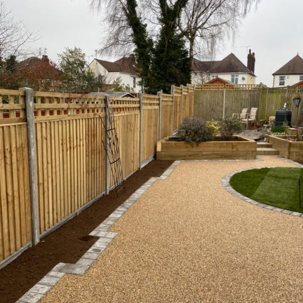 solid fence with a nice resin patio
